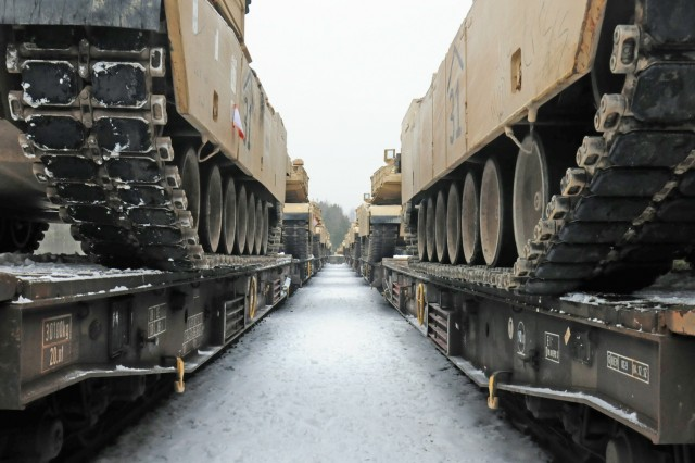 ZAGAN, Poland - M1A2 Abrams tanks belonging to 1st Battalion, 66th Armored Regiment, 3rd Armored Brigade, 4th Infantry Division have been loaded onto a flatcar railway Jan. 25, 2017. The vehicles will be shipped to Grafenwoehr, Germany to be used by the Soldiers as they conduct training in Eastern Europe as part of Operation Atlantic Resolve. The movement of equipment and troops into and around Europe kicks off what will be a continuous rotation of armored brigades from the United States as part of Operation Atlantic Resolve. The Iron Brigade's move to Germany will enhance deterrence capabilities in the region and improve the U.S. ability to respond to potential crisis and defend its allies and partners within the European community.
