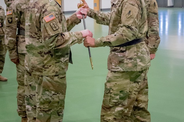 Command Sgt. Maj. James Breckinridge assumes responsibility as command sergeant major of the U.S. Army Military Police School with a symbolic passing of the noncommissioned officer's sword from MP School commandant, Brig. Gen. Kevin Vereen.