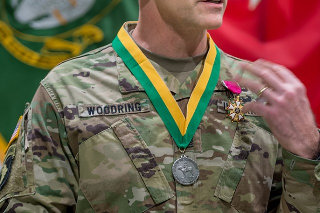 Command Sgt. Maj. Richard Woodring, outgoing  command sergeant major of the U.S. Army Military Police School, received a Legion of Merit and the Silver Military Police Order of the Marechaussee award.