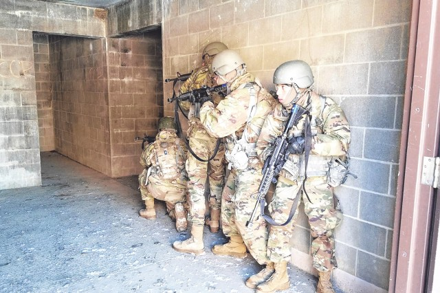 Soldiers of Company B, 35th Engineer Battalion, conduct Military Operations in Urban Terrain training during One Station Unit Training. Pvt. Joseph Salas, right, is responsible for rear security for the team. During this practical exercise, Soldiers are required to demonstrate their understanding of the principles of room clearing and the rules of engagement while eliminating a threat.