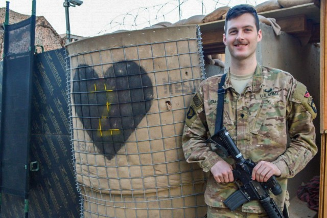 Spc. Erik Salmon, 26, an intelligence analyst assigned to the 2nd Brigade Combat Team, 101st Airborne Division, poses for a photograph while deployed in support of Operation Inherent Resolve, at Camp Swift, Jan. 8, 2017. Salmon assisted in the recovery of an isolated Iraqi Security Forces (ISF) soldier while working as a member of a U.S. and Iraqi advise and assist operations cell.
