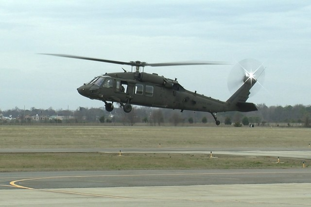 The engineering development model UH-60V Black Hawk hovers above the runway as part of its successful initial test flight Jan. 19 in Meridianville, Al.  The UH-60V is being designed to update existing UH-60L analog architecture with a digital infrastructure to address evolving interoperability and survivability requirements.