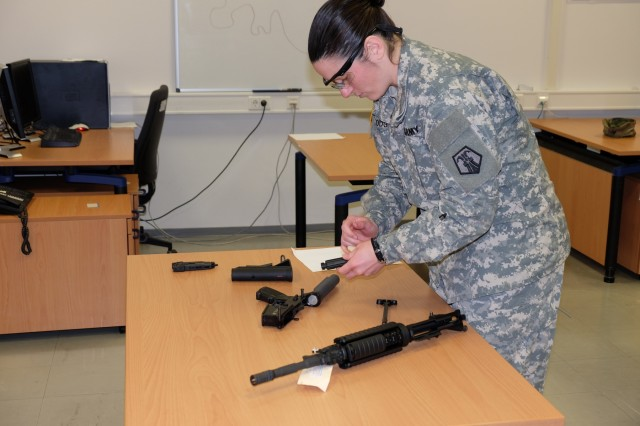 KAISERSLAUTERN, Germany - Sgt. Erin Hodge, from the office of the surgeon, 7th Mission Support Command, assembles an M4 rifle during the noncommissioned officer Best Warrior Competition Jan. 23, 2017.