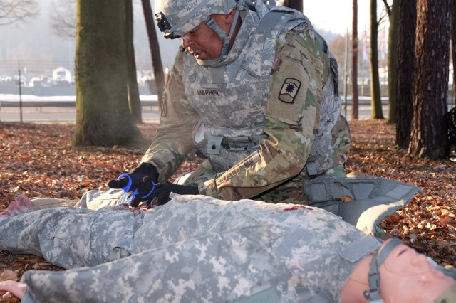 KAISERSLAUTERN, Germany - Spc. Baholo Maphiri from Headquarters and Headquarters Company, 457th Civil Affairs Battalion, 7th Mission Support Command, treats a simulated casualty during the 7th MSC enlisted Best Warrior Competition Jan. 23, 2017.