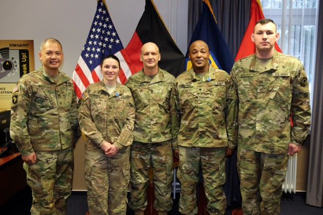 KAISERSLAUTERN, Germany - Left to right, Col. Alex Wells, deputy commanding officer, 7th Mission Support Command, Sgt. Erin Hodge, office of the surgeon; Command Sgt. Maj. Raymond Brown, senior enlisted leader; Spc. Baholo Maphiri, Headquarters and Headquarters Company, 457th Civil Affairs Battalion and Sgt. Peter Bickelhaupt, HHC, 361st Civil Affairs Brigade, pose for a picture Jan. 24, 2017 after the Best Warrior Competition award ceremony. Maphiri won the enlisted BWC category, while Hodge won the noncommissioned officer BWC in a close contest with Bickelhaupt. The two winners are now scheduled to compete in the 21st TSC and U.S. Army Reserve Command's BWCs as the 7th MSC representatives.