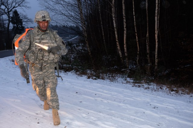 KAISERSLAUTERN, Germany - Spc. Baholo Maphiri from Headquarters and Headquarters Company, 457th Civil Affairs Battalion, 7th Mission Support Command, hurries during the 7th MSC enlisted Best Warrior Competition ruck march, Jan. 24, 2017.
