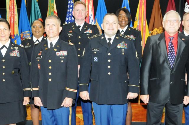 Back row: Master Sgt. Lynn Rochelle Roberts, CW3 Michael McDaniels, Sgt. 1st Class Crystal D. Singer and CW4 Dana Brewer. Front row: Col. Elizabeth Medina, Lt. Col. Joseph Harvey, Staff Sgt. Joshua Hopson and Brett Smith.
