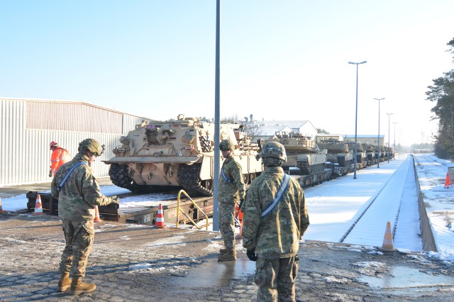 Troops unload the first 19 heavy tanks from 1st Battalion, 66th Armor Regiment. The 1-66 Regiment arrived at U.S. Army Garrison Bavaria in Grafenwoehr, Germany, Jan. 27. The regiment will participate in Exercise Combined Resolve VIII while at the Grafenwoehr Training Area.