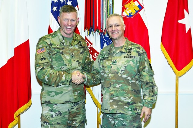 From left , Maj. Gen. Joseph P. Harrington, U.S. Army Africa commanding general and Brig. Gen Paul H. Pardew, Expeditionary Contracting Command commanding general, pose for a photo in the USARAF commander's office at Caserma Ederle in Vicenza, Italy, Jan. 18, 2017.
