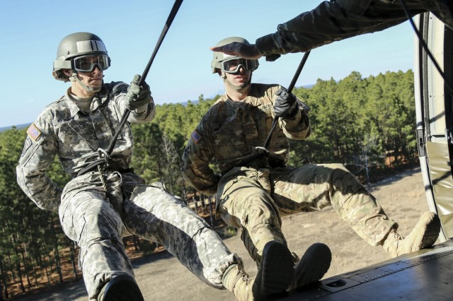 XVIII Airborne Corps DeGlopper Air Assault School students listen to instructions from their sergeant, as they prepare to rappel from a UH-60 Black Hawk Helicopter at Fort Bragg, N.C., Jan. 25, 2017. The course which spans over 10 days is intended to train Soldiers in the use of sling load transportation and for Air Assault operations. (U.S. Army photo by Pfc. Hubert D. Delany III/22nd Mobile Public Affairs Detachment)