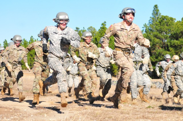 Students from the XVIII Airborne Corps' DeGloppers Air Assault School, Fort Bragg N.C., run to formation to start their rappelling techniques from a UH-60 Black Hawk helicopter hovering 70 -- 100 feet on Jan 25, 2017, at U.S. Army Simmons Airfield. (U.S. Army photo by Staff Sgt. Sharon Matthias/22nd Mobile Public Affairs Detachment)