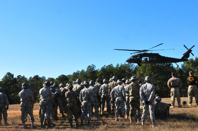 Soldiers from the XVIII Airborne Corps' DeGloppers Air Assault School, Fort Bragg N.C., stand ready to test their abilities on rappelling from a UH-60 Black Hawk helicopter on Jan. 25, 2017, at the U.S. Army Simmons Airfield. (U.S.Army photo by Staff Sgt. Sharon Matthias/22nd Mobile Public Affairs Det.)