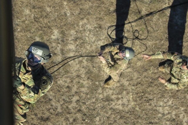 XVIII Airborne Corps DeGlopper Air Assault School student rappels from a UH-60 Black Hawk Helicopter at Fort Bragg, N.C., Jan. 25, 2017. The course which spans over 10 days is intended to train Soldiers in the use of sling load transportation and for Air Assault operations. (U.S. Army photo by Pfc. Hubert D. Delany III/22nd Mobile Public Affairs Detachment)