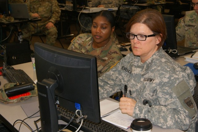 (Left to right) Staff Sgt. Princess Adu and Sgt. Maj. Teresa Beverley go over the rubrics block of instruction as part of the 80th Training Command's first Quality Assurance Officer course at Grand Prairie, Texas, Jan. 24, 2017.