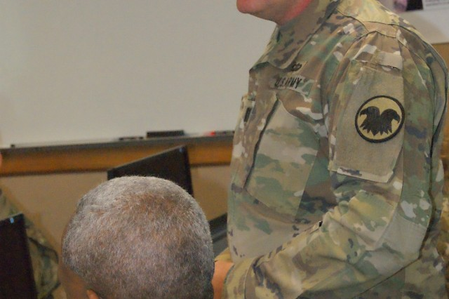 Capt. Tanny Retz discusses the U.S. Army Reserve Command's role in Quality Assurance Officer training at the 80th Training Command's first QAO course held at Grand Prairie, Texas, Jan. 24, 2017.
