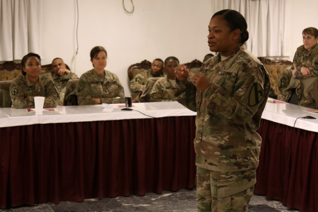 Command Sgt. Major Jill L. Crosby, command sergeant major, 1st Cavalry Division Resolute Support Sustainment Brigade, speaks at the Sisters in Arms Forum at Bagram Airfield, Afghanistan, Jan. 24. More than 40 Soldiers, male and female, attended the forum that was developed for female Soldiers to help enhance avenues of mentorship and empowerment in order to reach their full potential.