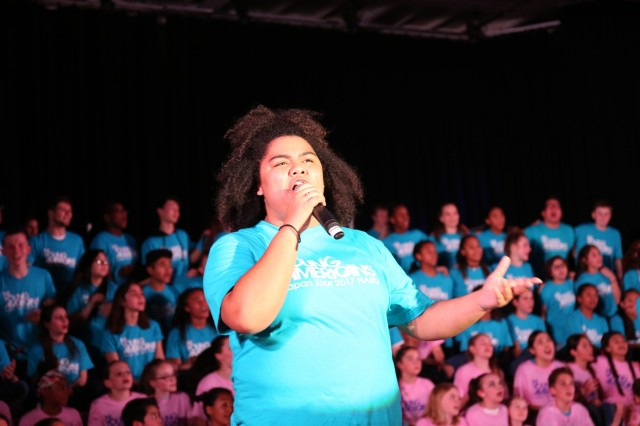 Kamanelelehua Clemens, 11th-grader at Zama American High School, sings during the annual Young Americans' performance night held Jan. 26 inside Arnn Elementary School's cafeteria on Sagamihara Family Housing Area after the three-day workshop. (U.S. Army Photos by Noriko Kudo)