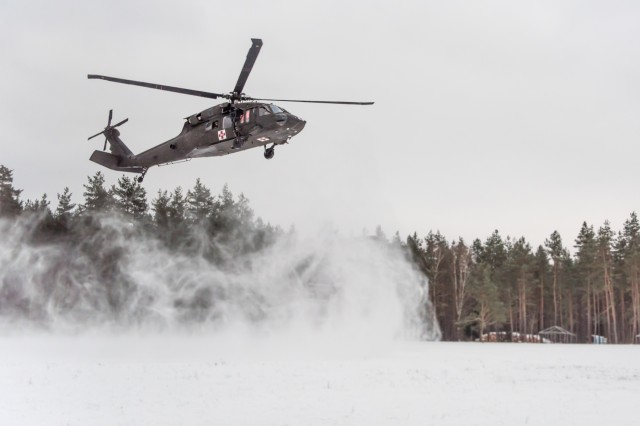 GRAFENWOEHR, Germany - A UH-60A/L Blackhawk helicopter from C Company, 1-214th General Support Aviation Battalion arrives to conduct MEDEVAC training with Soldiers the 67th Forward Surgical Team, 64th Medical Detachment Veterinary Service Support, and 3rd Squadron, 2nd Cavalry Regiment, Jan. 10, 2017.  (U.S. Army Photo by Maj. Chris N. Angeles, 67th Forward Surgical Team)