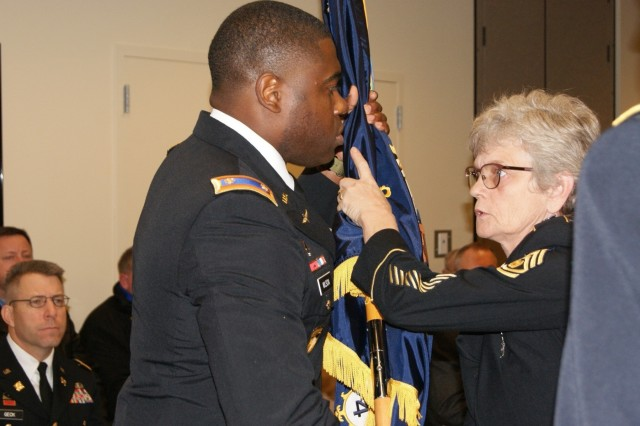 (Left) Maj. Marquis Wilson, commander of the 4th Battalion, 321st Regiment, receives his battalion's colors from Command Sgt. Maj. Loriann Schlafer, 4th Battalion command sergeant major, at the battalion's deactivation ceremony at Redstone Arsenal, Ala., Dec. 18, 2016. The deactivation is part of the 800th Logistics Support Brigade restructuring, which is a result of the overall Army Reserve drawdown.