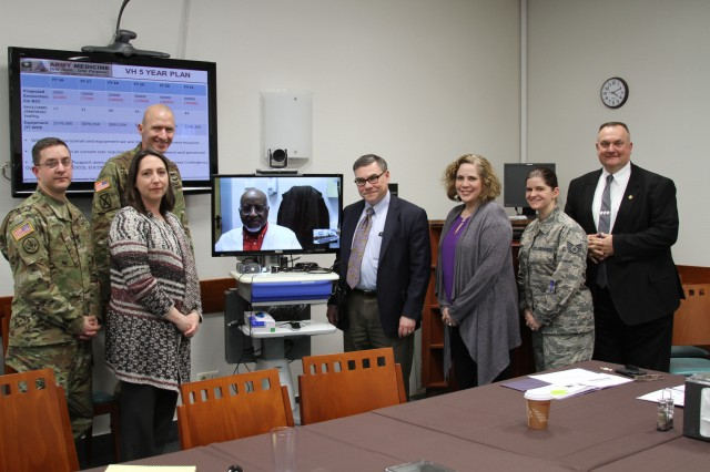 Robert Goodman, Chief of staff, Office of the Surgeon General and U.S. Army Medical Command, poses with the Regional Health Command Europe Virtual Health Team at Landstuhl Regional Medical Center. During his visit, the team highlighted recent successes and outlined 2015 cost savings that resulted in the program being recognized with a U.S. Army Medical Command Wolf Pack Award for 2016.