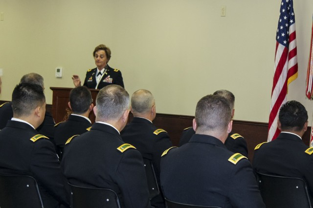 Command Warrant Officer 5 Mary Hostetler, command chief for the 200th Military Police Command, Army Reserve, delivers a speech during a Warrant Officer Advance Course graduation ceremony which was scheduled and funded specifically for U.S. Army Reserve warrants at the U.S. Army Military Police School, Fort Leonard Wood, Missouri, Sept. 23. (U.S. Army courtesy photo)