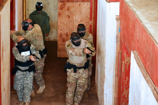 U.S. Army reservists with the 414th Military Police Company headquartered in Joplin, Mo., participate in an active shooter training exercise as part of the company's law enforcement integration and certification training provided by U.S. Army MP Soldiers from the 728th MP Battalion, 8th MP Brigade, 8th Theater Sustainment Command, Sept. 4-28 at Schofield Barracks, Hawaii. (U.S. Army photo by Staff Sgt. Taresha Hill, 8th Military Police Brigade Public Affairs, 8th Theater Sustainment Command)