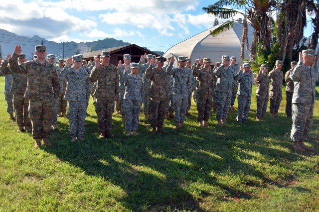 U.S. Army reservists with the 414th Military Police Company headquartered in Joplin, Mo., raise their right hands and recite the law enforcement officer oath after completing their law enforcement integration and certification training provided by U.S. Army MP Soldiers from the 728th MP Battalion, 8th MP Brigade, 8th Theater Sustainment Command, Sept. 4-28 at Schofield Barracks, Hawaii.