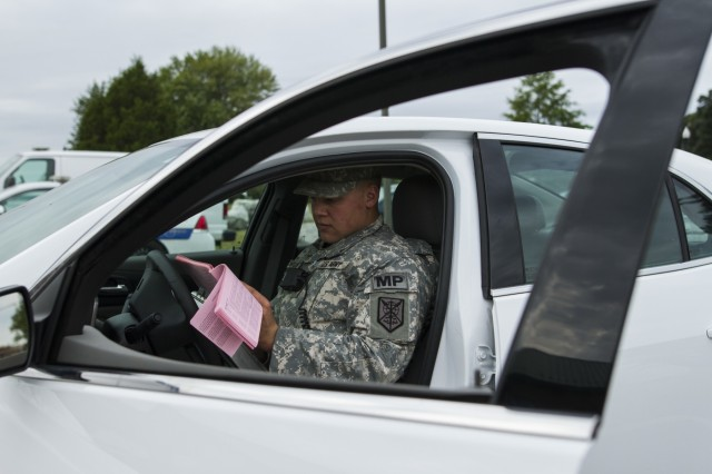 Spc. Bradley A. Skowronski, a U.S. Army Reserve military police Soldier assigned to the 102nd MP Company out of Sheboygan, Wisc., reviews a report at Fort Meade, Md., Sept. 16, 2016. Skowronski is part of a group of Soldiers participating in   the on going partnership between the 200th Military Police Command and the Military District of Washington.  Through this partnership, the military police Soldiers not only receive their law enforcement certification, they also get real-world experience, which is something they don't get during a training exercise. (U.S. Army Reserve photo by Spc. Stephanie Ramirez)