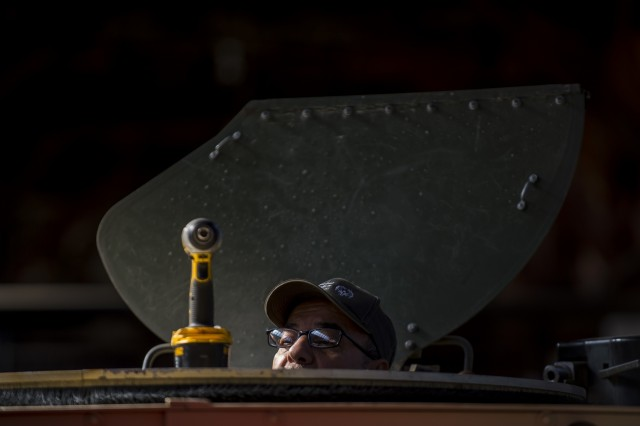 Pablo Flores, an installer and instructor for the Materiel Fielding & Training Team, prepares a turret to install a Common Remotely Operated Weapon Station (CROWS), at Fort Chaffee, Arkansas, Jan. 26. The CROWS is a remote-controlled system compatible with four major crew-serve weapons, and it was developed to keep gunners safe within the vehicle while engaging enemy targets.