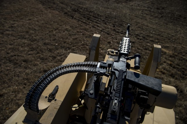 An M240B machine gun is mounted to a Common Remotely Operated Weapon Station (CROWS) during a fielding to U.S. Army Reserve units at Fort Chaffee, Arkansas, Jan. 27, as part of a four-part fielding process intended to field CROWS to more than 25 Army Reserve units this fiscal year. The CROWS is a remote-controlled system compatible with four major crew-serve weapons, and it was developed to keep gunners safe within the vehicle while engaging enemy targets.