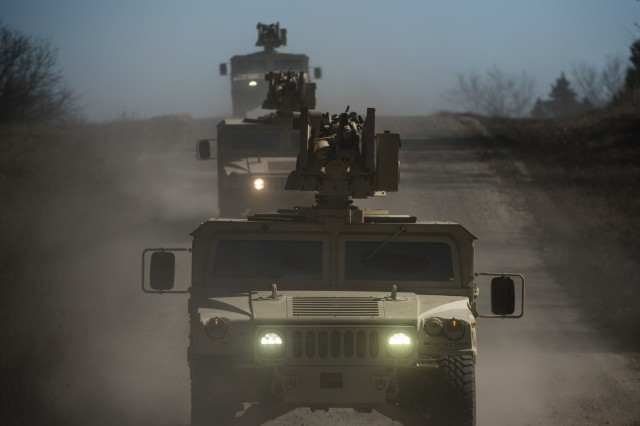 Common Remotely Operated Weapon Stations (CROWS) are mounted on top of a convoy of High Mobility Multipurpose Wheeled Vehicles during a fielding to U.S. Army Reserve units at Fort Chaffee, Arkansas, Jan. 27. The CROWS is a remote-controlled system compatible with four major crew-serve weapons, and it was developed to keep gunners safe within the vehicle while engaging enemy targets.