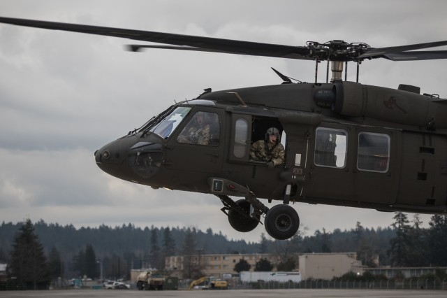 U.S. Army UH-60M Black Hawk helicopter pilots assigned to 16th Combat Aviation Brigade, 7th Infantry Division fly overhead during training at Joint Base Lewis-McChord, Wash., Jan. 26, 2017. The pilots and Soldiers from 16th CAB were supported by U.S. Army Reserve Soldiers, who provided Forward Area Refueling Equipment in a CH-47 Chinook helicopter to prepare the 16th CAB Soldiers for their upcoming mission in Afghanistan.