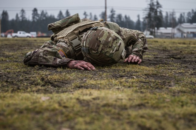 A U.S. Army Soldier assigned to 16th Combat Aviation Brigade, 7th Infantry Division low crawls during combat lifesaver training at Joint Base Lewis-McChord, Wash., Jan. 26, 2017. 16th CAB medics led the training, which included U.S. Air Force Special Operations Tactical Air Control Party Specialists (TACP) to prepare attendees to care for the wounded during real-world operations.