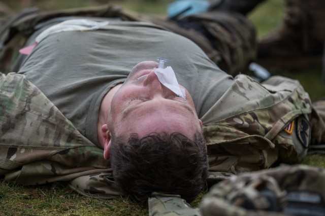 A U.S. Army Soldiers assigned to 16th Combat Aviation Brigade, 7th Infantry Division acts as a simulated casualty during combat lifesaver training at Joint Base Lewis-McChord, Wash., Jan. 26, 2017. 16th CAB medics led the training, which included U.S. Air Force Special Operations Tactical Air Control Party Specialists (TACP) to prepare attendees to care for the wounded during real-world operations.