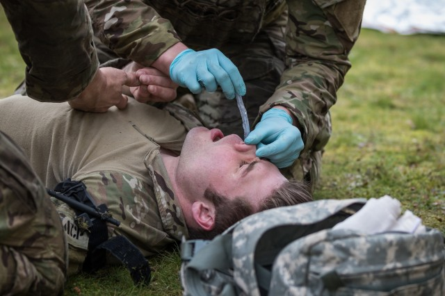 U.S. Air Force Tactical Air Control Party Specialists (TACP)establish a nasopharyngeal airway on a simulated casualty during combat lifesaver training at Joint Base Lewis-McChord, Wash., Jan. 26, 2017. U.S. Army medics assigned to 16th Combat Aviation Brigade, 7th Infantry Division led the training to prepare TACP and 16th CAB Soldiers to provide care to the wounded during real-world missions.