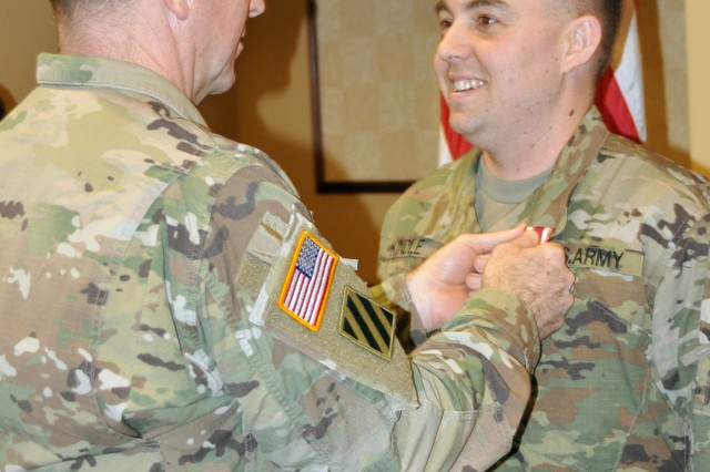 General Abrams, FORSCOM Commander, pins the Meritorious Service Medal on Staff Sgt. Matthew Kindle from I Corps who was named the FORSCOM Active Duty Career Counselor of the Year. (Photo credit: Ms. Lisa Ray, FORSCOM Public Affairs)