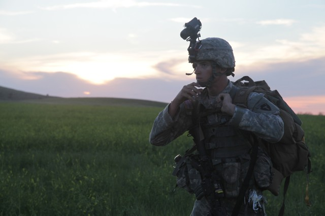 Spc. Clayton Weldon with the 1st Battalion, 143rd Airborne Infantry Regiment, Texas Army National Guard, looks for his squad at the rally point during the Golden Coyote training exercise, at Camp Guernsey, Guernsey, Wyoming, June 15, 2015. Steerable parachutes were supposed to make it easier for widely scattered paratroopers to reassemble into units after a jump. (U.S. Army photo by Spc. Tamara Cummings)