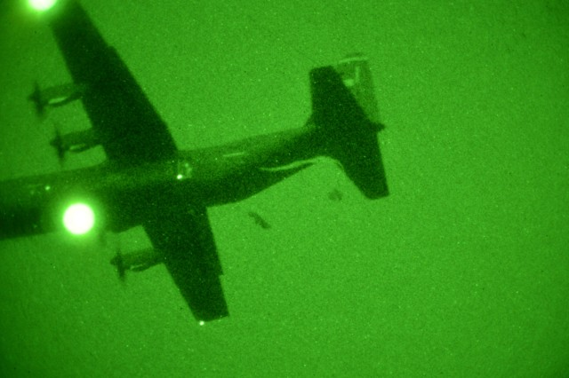U.S. Army paratroopers from 173rd Brigade Support Battalion conduct a night airborne operation with a U.S. Air Force 86th Air Wing C-130 Hercules aircraft in Pordenone, Italy, Feb. 24, 2015. The midair maneuvering the MC1-1 aimed for was in some ways a strange goal to pursue: In combat, most jumps happen under cover of darkness and too close to the ground for Soldiers to have time to steer. (U.S. Army photo by Visual Information Specialist Massimo Bovo)