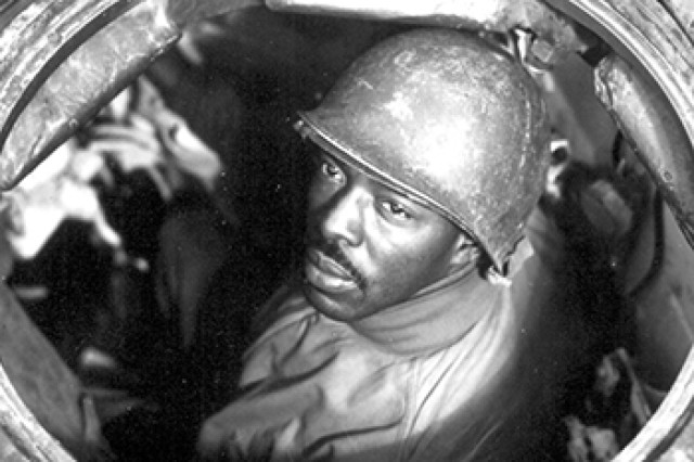 Gunner Cpl. Carlton Chapman poses in the hatch of his M4 Sherman tank near Nancy, France, Nov. 5, 1944. Chapman served in the 761st Tank Battalion, the first African-American tank unit to go into combat. The unit's first engagement came Nov. 8, only days after this photo was taken.
