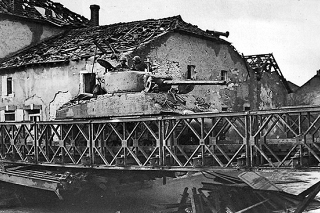 A tank from Able Company, 761st Tank Battalion, crosses the Seille River in France, Nov. 9, 1944, the unit's second of 183 days in combat. That November was particularly bloody, with 22 Soldiers killed in action. Ultimately, the battalion -- the first African-American tank unit to go into battle -- earned four campaign medals, 11 Silver Stars, 69 Bronze Stars and about 300 Purple Hearts. A Medal of Honor and a Presidential Unit Citation came later.