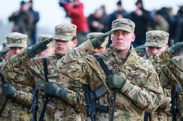 "Soldiers from the 3rd Armored Brigade Combat Team, 4th Infantry Division march in formation during the ""Pass and Review"" portion of the Welcome Event for their unit, at Karliki Range, Zagan, Poland on January 30th 2017. The ceremony welcomed American Soldiers from 3rd Armored Brigade Combat Team, 4th Infantry Division to Poland and also featured the first live fire training exercise between the two nations. The American Soldiers arrived in Poland earlier this month to begin a nine-month rotation in support of Operation Atlantic Resolve. (U.S. Army photo by Sgt. Devone Collins/ 24th Press Camp Headquarters)"