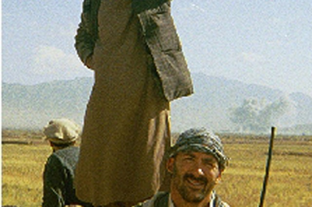 Now-retired Air Force Chief Master Sgt. Calvin Markham poses in Afghanistan with a local resistance fighter in 2001. As a combat controller with Air Force Special Operations Command, Markham served with one of the first American ground teams to go into Afghanistan following 9-11. Some of his most important duties included finding areas to establish an airhead and scout locations for airdrops, and, of course, to call in air strikes, many of which were danger close to American and coalition positions.
