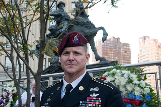 Command Sgt. Maj. Mark Baker of the 160th Special Operations Aviation Regiment (Airborne) poses in front of De Oppresso Liber, or the Horse Soldier, a 16-foot bronze statue honoring the work of Special Forces Soldiers in Afghanistan at the beginning of Operation Enduring Freedom in the last months of 2001. As a flight engineer on a 160th SOAR MH-47 Chinook, Baker helped transport the first Special Forces teams into Afghanistan through horrible weather and in some of the most challenging flying conditions in history.