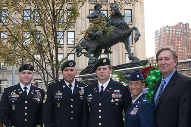 "Left to right: Chief Warrant Officer 2 Brad Fowers, Master Sgt. Keith Gamble, Maj. Mark Nutsch, Air Force Lt. Col. Allison Black and author Doug Stanton pose in front of De Oppresso Liber, or the Horse Soldier, a 16-foot bronze statue honoring the work of Special Forces Soldiers in Afghanistan at the beginning of Operation Enduring Freedom in the last months of 2001. Recently rededicated, the statue stands near ground zero in New York. Fowers, Gamble and Nutsch served on some of the Special Forces teams that the statute recognizes. Stanton wrote a best-selling book about some of their experiences, ""Horse Soldiers."""