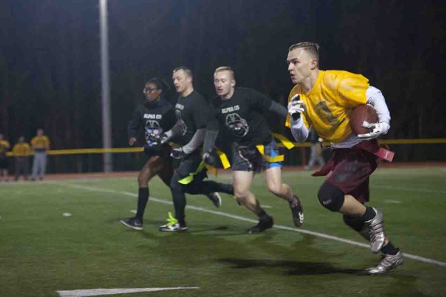 Dylan Woll, California Medical Detachment, breaks one of his many sweeps for big yardage during CalMed's 18-0 loss to Co. A, 229th MI Battalion, in the flag football championship semifinal Jan. 25.