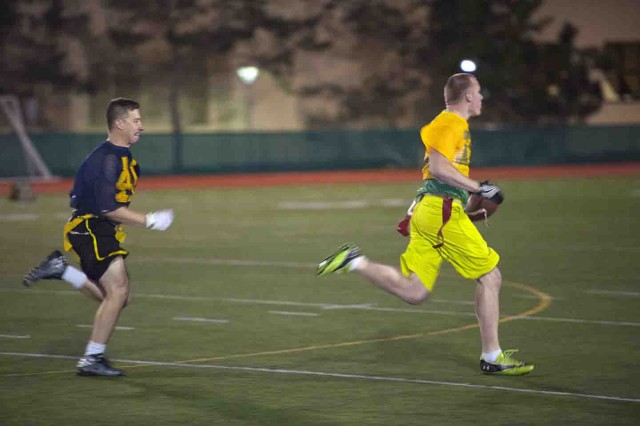 Rob McGuire (right), California Medical Group, returns an interception with Co. B, 229th MI Battalion's Alan Nardo (left) in pursuit during CalMed's 26-20 flag football semifinal win Jan. 25.