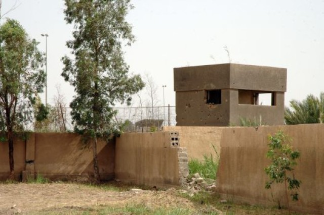 The tower at the courtyard in Iraq where soldiers from Company B, 11th Engineer Battalion, 3rd Infantry Division, were receiving gunfire April 4, 2003, the day Medal of Honor recipient Paul R. Smith lost his life. The tower stands riddled with bullet holes.