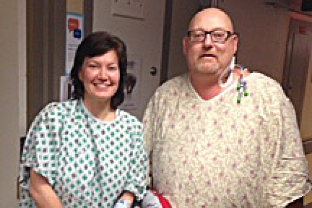Donia Lawson, a pharmacist at Ireland Army Health Clinic on Fort Knox, and Gene Bumgardner together after surgery. It was the first time they were free of medical equipment and could actually get close enough for a picture.