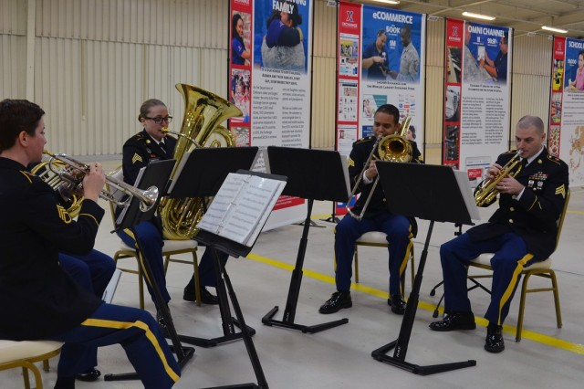 Members of the U.S. Army Band play for guests during the grand opening of the Army & Air Force Exchange Service's new distribution center at Germersheim Army Depot Feb. 1. The new distribution center will serve as the logistical hub for supplying goods to troops and military families throughout Europe and Southwest Asia.