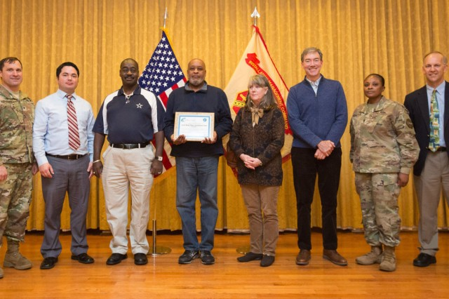 Joint Base Myer-Henderson Hall Commander Col. Patrick M. Duggan (far left) poses with staffers from the Directorate of Public Works, Environmental Management Division as they receive the Virginia Department of Environmental Quality Certificate of Achievement during an awards ceremony Jan. 26. Also pictured are JBM-HH Command Sgt. Maj. Carolyn Y. Donaldson (second from right) and Chief of Staff Glenn Wait (far right). Staffers, from left after Duggan, are Richard LaFreniere, division chief, Roy Croom, Mark Luckers, Kristie Lalire and Greg Olmsted.